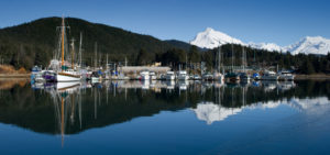 Boats docked at Andrew's Marina at Fishermen's Bend in Auke Bay are reflected in March 2013.